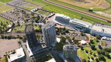 An artist's impression of planned apartment towers next to Flemington Racecourse railway station.