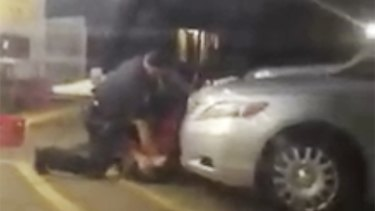 Alton Sterling is detained by two Baton Rouge police officers outside a convenience store. Moments later, one of the officers shot and killed Sterling.