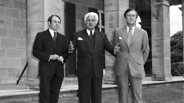 Prime Minister Malcolm Fraser (right) with governor-general John Kerr (centre) and John Howard on the lawns of Admiralty House after the swearing in of Mr Howard as the new treasurer in 1977.