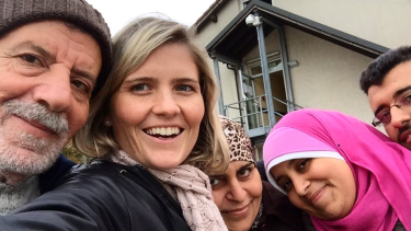 Sophie McNeill with Syrian refugee Nazieh Husein and his family, reuinted and safe in Germany.