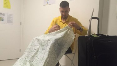 Shower scene from Rio: Andrew Bogut putting the shower curtain up in his bedroom