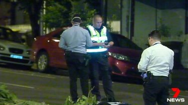 Police at the scene of the attack in North Melbourne.