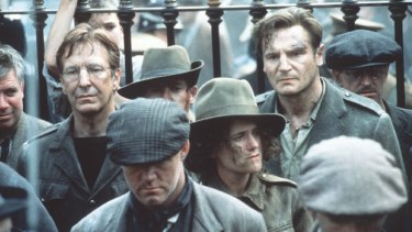 Alan Rickman and Liam Neeson in Michael Collins (1996).