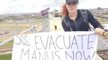 One of the protesters on top of the crane at Flemington.