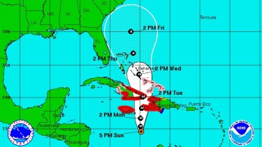 This graphic shows the coastal areas under a hurricane warning in red, and those on hurricane watch in pink.