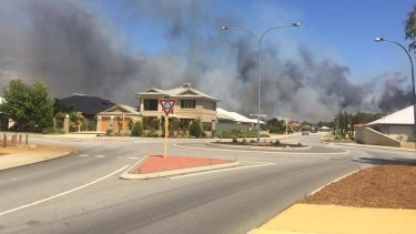 A bushfire in Kenwick was threatening lives and homes on Monday.