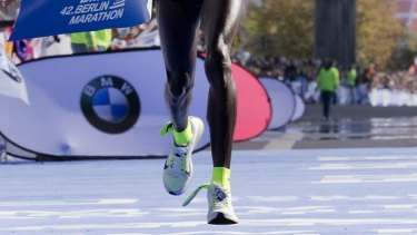 Got sole: Eliud Kipchoge crosses the finish line to win the Berlin Marathon.