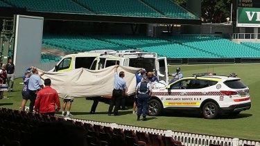 Paramedics treat Phillip Hughes at the Sydney Cricket Ground on Tuesday.
