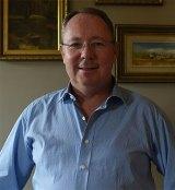 "Labor MP Hugh McDermott says the Premier has ""bought political muscle""."