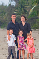 The Willetts family on Port Douglas' Four Mile Beach where they harvest wild-growing coconuts.