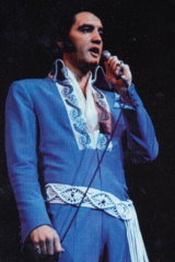 Elvis Presley wears the ivory macrame belt with accented reflective stones that sold in auction.