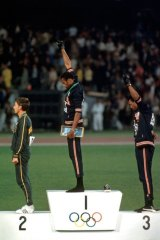 Australia's Peter Norman on the medal dais at the 1968 Olympics in Mexico City as US athletes Tommie Smith  and John Carlos give the Black Power salute.