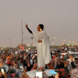 Alaa Salah singing traditional songs to protesters in Sudan in a photo by activist Lana Haroun.