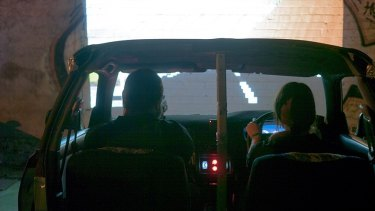 <i>Bush Bash</i> uses the shell of a real car as a setting for a two-player driving and shooting game.