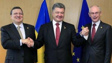 Ukraine's President Petro Poroshenko with European Commission President Jose Manuel Barroso (left) and European Council President Herman Van Rompuy (right) in Brussels.