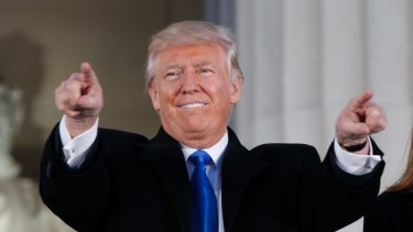 """President-elect Donald Trump and his wife Melania arrive to the """"Make America Great Again Welcome Concert"""" at the Lincoln Memorial on January 19."""