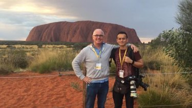 Michael Gordon on assignment with photographer Alex Ellinghausen in Uluru in 2017.