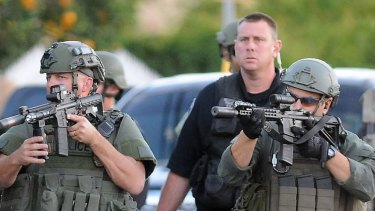 Authorities search for a gunman at an incident in the US in late 2015.