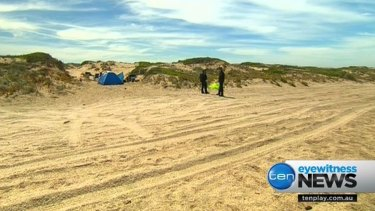 Police at the beach near where the alleged abduction took place.