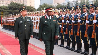 Zimbabwean military chief Constantino Chiwenga, right, inspects Chinese troops in Beijing with General Li Zuocheng during his visit earlier this month.