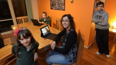 Deaf yoga teacher and mother Karli Dettman, with her children at home in Melbourne.