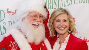 Olivia Newton-John, right, and Santa Claus, in Hollywood. She and John Farnham have released a Christmas album this year.