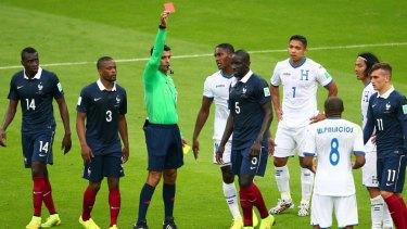 Wilson Palacios of Honduras is shown a red card.