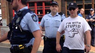 Police arrest Iain Fogerty in New Farm.