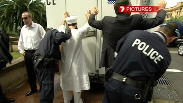 Morrow, left, and Chas Licciardello are detained by police during APEC, in September 2007.