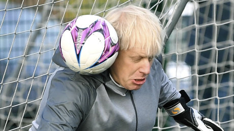 Britain's Prime Minister Boris Johnson stands in goal prior to a  Juniors girls soccer match between Hazel Grove United JFC and Poynton, as he campaigns in Cheadle Hulme, England, Saturday, Dec. 7, 2019.