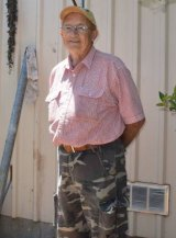 Eric Holland first spotted the giant goanna outside the steps of his shed.