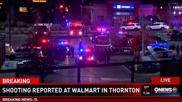 The scene was chaotic with police and witnesses unsure if the gunman was holed up inside the Walmart.