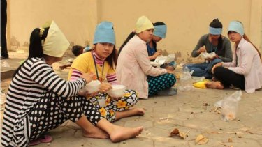 Garment factory workers in Cambodia during their lunch break.
