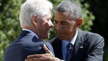 US President Barack Obama with Bill Clinton.