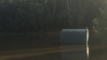 One of two AGL tanks dislodged by the flooded Nepean River.