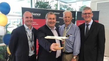 Alliance Airlines lands in Bundaberg - with CEO Lee Schofield (far left) greeted by Bundaberg Mayor Jack Dempsey (second from left).