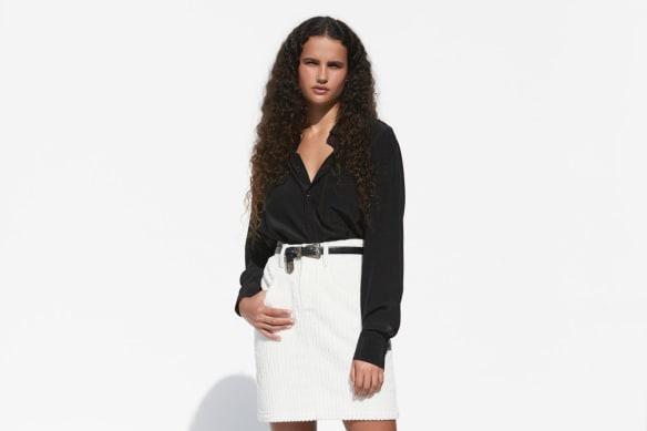 Bassike shirt, $395. Michael Lo Sordo skirt, $350. Calvin Klein Jeans boots, POA (worn throughout). Belt, stylist's own.