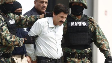 """Drug lord Joaquin """"Shorty"""" Guzman  is escorted by soldiers in Mexico City after his capture last year for a previous prison escape."""