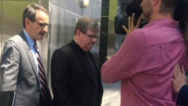 Father Walshe leaves the  Royal Commission into Institutional Responses to Child Sexual Abuse last year.