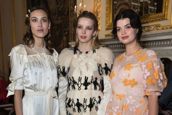 Alexa Chung, Greta Bellamacina and Pixie Geldof pose for photographers before the Simone Rocha Autumn/Winter 2018 fashion week runway show.