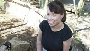 Dr Janine Deakin and tumour-prone friend, a Tasmanian devil.