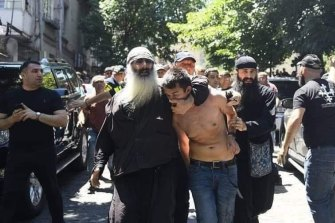 The photograph published by Open Caucasus Media that the organisation says shows an orthodox priest in Tbilisi dragging away a local journalist whose shirt has been torn off.