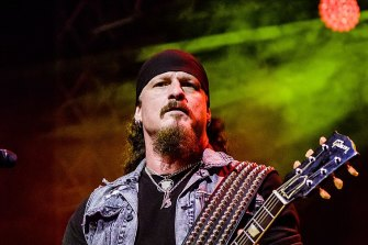 Jon Schaffer, guitarist with heavy metal band Iced Earth, turned himself in after seeing his face on a wanted poster.