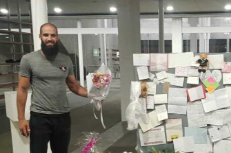 Richmond footballer Bachar Houli visits a memorial to the Christchurch massacre victims.