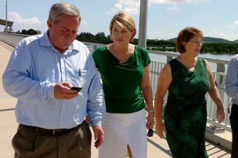 Then-premier Anna Bligh and Treasurer Andrew Fraser, with local MPs Tim Mulherin (Mackay) and Jan Jarratt (Whitsunday) walking over the Pioneer River. Photo: Tony Moore