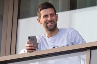 Novak Djokovic takes in the view from his quarantine hotel in Adelaide.