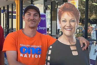 Former One Nation candidate Dean Smith, who underwent a recruitment interview with US-based neo-Nazi group The Base, with a cutout of Pauline Hanson.