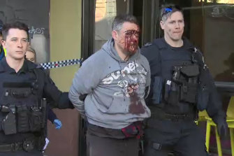Jonathan Dick, with his face covered in blood, as he was arrested in Melbourne's CBD on Monday morning.