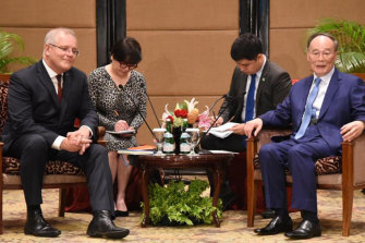 Scott Morrison meets with Chinese Vice-President Wang Qishan in Jakarta ahead of the inauguration.