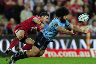 The Reds' Anthony Fainga'a, left, has left the game due to concern over the long-term effects of head knocks.